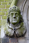 Statue of a king outside entrance to St Johns Winchester Charity Almshouses, High Street, Winchester, Hampshire, England
