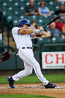 Round Rock Express catcher Brett Nicholas #19 swings the bat during the Pacific Coast League baseball game against the Memphis Redbirds on April 24, 2014 at the Dell Diamond in Round Rock, Texas. The Express defeated the Redbirds 6-2. (Andrew Woolley/Four Seam Images)