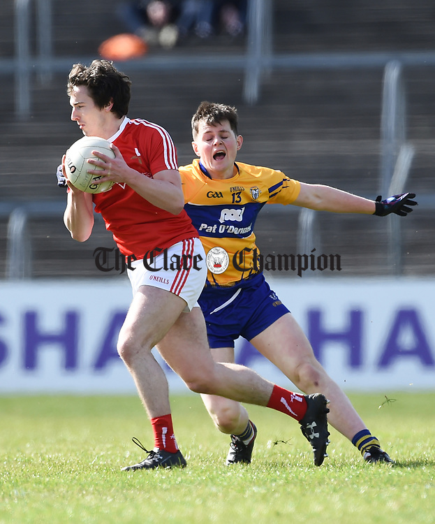 Eoghan Lafferty of Louth  in action against Conor Finucane of Clare during their national League game in Cusack Park. Photograph by John Kelly.