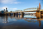 The Willamette River is not only one of the main distinguishing natural features of downtown Portland Oregon, but also bisects the city from East to West.