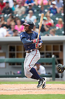 Mycal Jones (5) of the Gwinnett Braves follows through on his swing against the Charlotte Knights at BB&T BallPark on July 3, 2015 in Charlotte, North Carolina.  The Braves defeated the Knights 11-4 in game one of a day-night double header.  (Brian Westerholt/Four Seam Images)