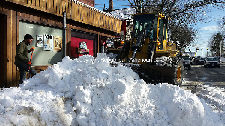 WATERTOWN, CT, 29 January 2015-012915LW01 - John Bourdeau, left, owner of the Main Street Grill in Watertown, shovels snow into the road for Erik Markiewicz, in payloader, to scoop up and remove Thursday afternoon. Laraine Weschler Republican-American