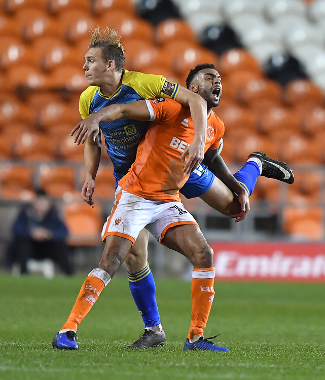 Blackpool's Curtis Tilt gets an elbow in the face from Solihull Moors' Danny Wright<br /> <br /> Photographer Dave Howarth/CameraSport<br /> <br /> The Emirates FA Cup Second Round Replay - Blackpool v Solihull Moors - Tuesday 18th December 2018 - Bloomfield Road - Blackpool<br />  <br /> World Copyright © 2018 CameraSport. All rights reserved. 43 Linden Ave. Countesthorpe. Leicester. England. LE8 5PG - Tel: +44 (0) 116 277 4147 - admin@camerasport.com - www.camerasport.com