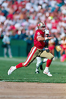 SAN FRANCISCO, CA - Steve Young of the San Francisco 49ers runs for a touchdown during a game against the Los Angeles Rams at Candlestick Park in San Francisco, California in 1992. Photo by Brad Mangin