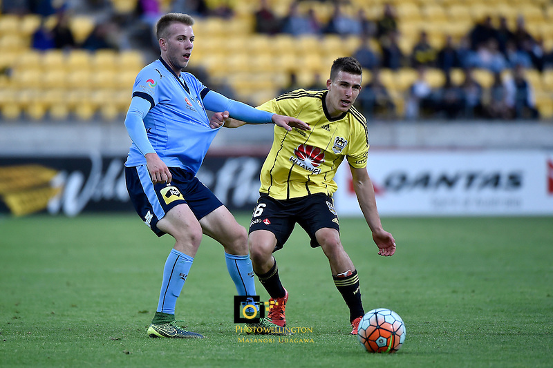 Wellington Phoenix&rsquo; Louis Fenton and Sydney Andrew Hoole in action during the A League - Wellington Phoenix v Sydney FC at Westpac Stadium, Wellington, New Zealand on Saturday 19 December 2015.<br /> Photo by Masanori Udagawa. <br /> www.photowellington.photoshelter.com.