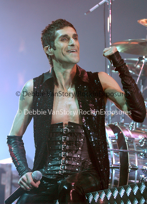 Perry Farrell of Janes Addiction performs at the KROQ Almost Acoustic Christmas 2003 Concert held at Universal Ampitheatre in Universal City on December 14,2003.                                                                            Copyright 2003 by RockinExposures