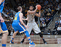 Christian Behrens of California controls the ball during the game against UCLA at Haas Pavilion in Berkeley, California on February 19th, 2014.  UCLA defeated California, 86-66.