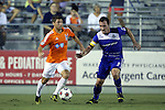 16 August 2014: Carolina's Enzo Martinez (URU) (left) and Edmonton's Albert Watson (NIR) (5). The Carolina RailHawks played FC Edmonton at WakeMed Stadium in Cary, North Carolina in a 2014 North American Soccer League Fall Season match. Edmonton won the match 3-2.