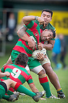 Kalolo Otutahua tries to avoid being wrapped up by George Crichton during the Counties Manukau Premier Club Rugby game between Pukekohe and Waiuku, played at Colin Lawrie Field, Pukekohe, on Saturday May 03 2014. Pukekohe won the game 28 - 10 afterleading 21 - 10 at halftime  Photo by Richard Spranger