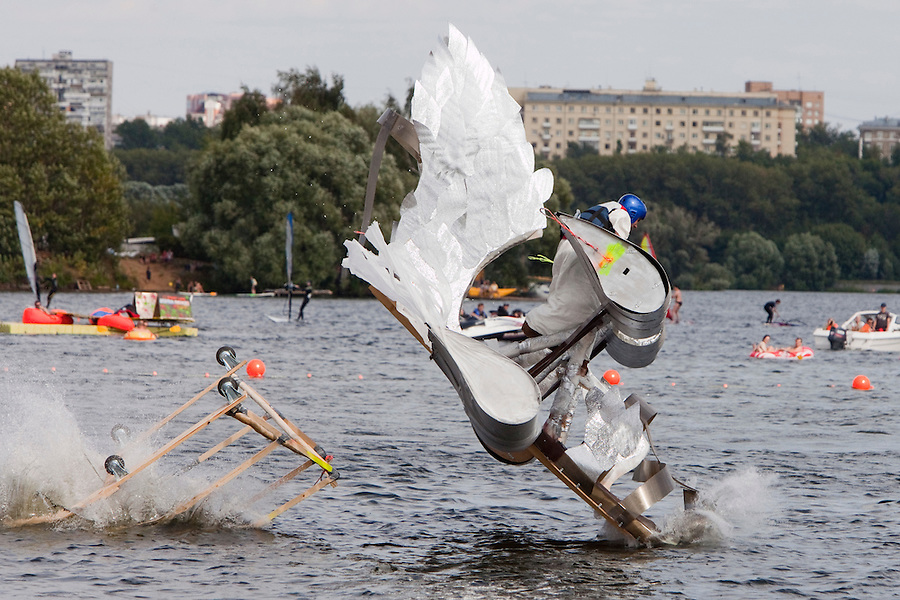 Moscow Russia, 07/08/2011..A contestant and his aircraft crash into the river at Red Bull Flugtag, when some 100,000 people gathered to watch a variety of homemade makeshift aircraft launched over and into the Moscow river.