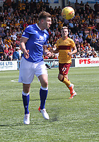 Darren Brownlie heading the ball in the SPFL Betfred League Cup group match between Queen of the South and Motherwell at Palmerston Park, Dumfries on 13.7.19.