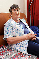 Pictured: Anne Parker in her house in Pontypridd, Wales, UK. Monday 02 July 2018<br /> Re: Pensioner Anne Parker says the peace and quiet of her garden has been shattered after a car wash was installed by rental firm Enterprise on the other side of her back fence in Pontypridd, Wales, UK.