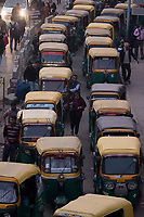 Rickshaws line up for passengers during the evening commute at HUDA City Centre in Gurugram, Haryana, India, on Mon., December 10, 2018.