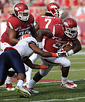 NWA Democrat-Gazette/ANDY SHUPE<br /> Arkansas' Rawleigh Williams III (right) is brought down by University of Texas at El Paso's Kelvin Fisher Jr. Saturday, Sept. 5, 2015, during the fourth quarter of play in Razorback Stadium in Fayetteville. Visit nwadg.com/photos to see more from the game.