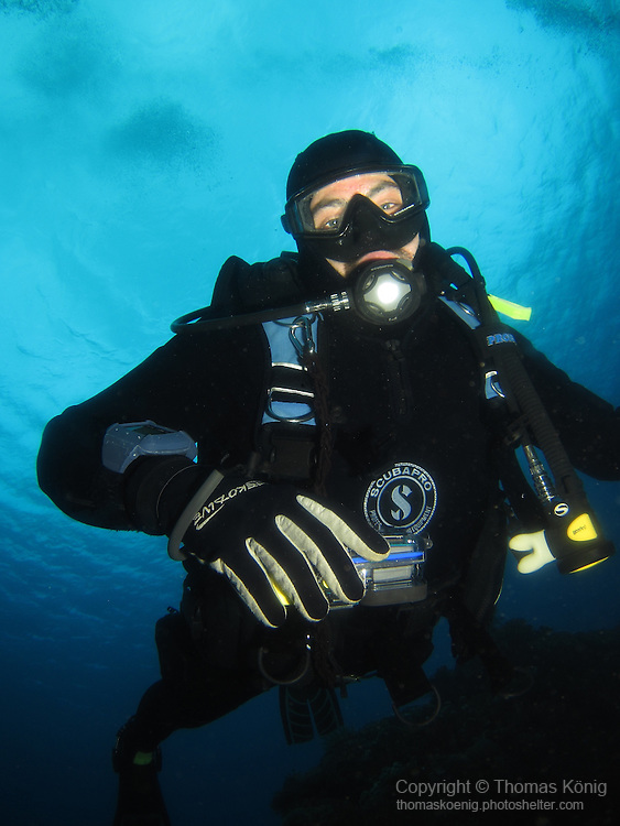 Shi Lang, Green Island - Diver against the water surface.