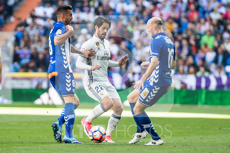 Isco Alarcon of Real Madrid competes for the ball with Gaizka Toquero and Victor Camarasa of Club Deportivo Alaves during the match of  La Liga between Real Madrid and Deportivo Alaves at Bernabeu Stadium Stadium  in Madrid, Spain. April 02, 2017. (ALTERPHOTOS / Rodrigo Jimenez)