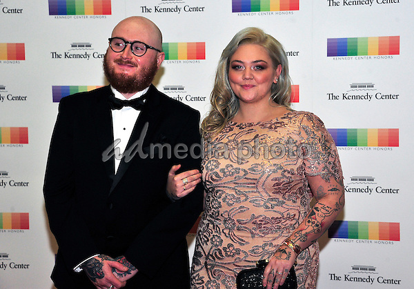 Singer Elle King and fiance Andrew Ferguson arrive for the formal Artist's Dinner honoring the recipients of the 39th Annual Kennedy Center Honors hosted by United States Secretary of State John F. Kerry at the U.S. Department of State in Washington, D.C. on Saturday, December 3, 2016. The 2016 honorees are: Argentine pianist Martha Argerich; rock band the Eagles; screen and stage actor Al Pacino; gospel and blues singer Mavis Staples; and musician James Taylor. Photo Credit: Ron Sachs/CNP/AdMedia