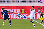 Davronbek Khashimov of Uzbekistan (R) in action as Takashi Inui of Japan (L) tackles him during the AFC Asian Cup UAE 2019 Group F match between Japan (JPN) and Uzbekistan (UZB) at Khalifa Bin Zayed Stadium on 17 January 2019 in Al Ain, United Arab Emirates. Photo by Marcio Rodrigo Machado / Power Sport Images