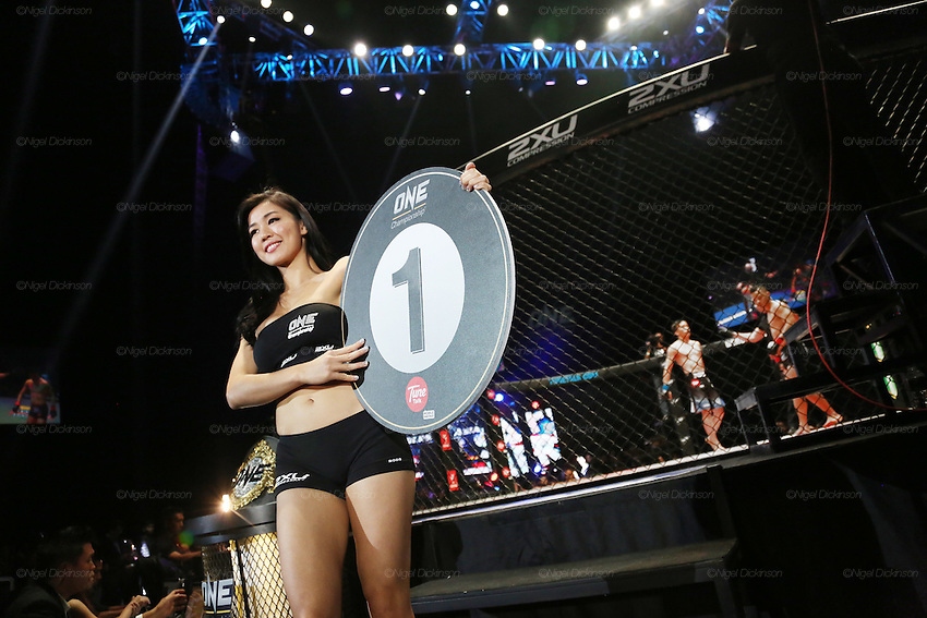 Ring girl walks around the cage announcing first round. Saiful Merican, 1st ranked WMA featherweight, fights Melvin Yeoh, South Malaysia Muay Thai Champion<br />