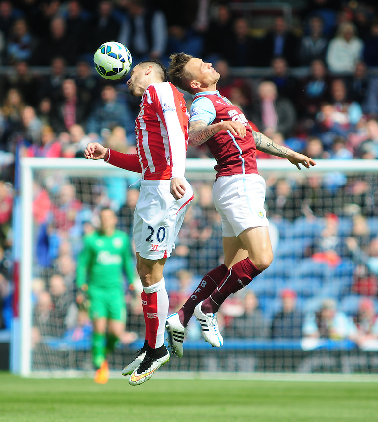 Stoke City's Geoff Cameron wins a header against Burnley's Matthew Taylor<br /> <br /> Photographer Andrew Vaughan/CameraSport<br /> <br /> Football - Barclays Premiership - Burnley v Stoke City - Saturday 16th May 2015 - Turf Moor - Burnley<br /> <br /> &copy; CameraSport - 43 Linden Ave. Countesthorpe. Leicester. England. LE8 5PG - Tel: +44 (0) 116 277 4147 - admin@camerasport.com - www.camerasport.com