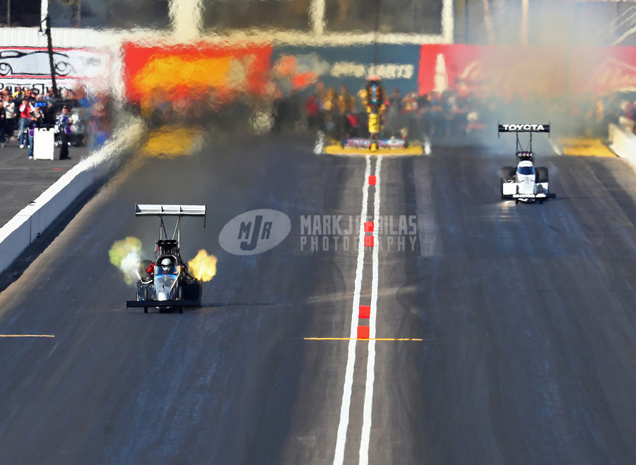 Feb 25, 2018; Chandler, AZ, USA; NHRA top fuel driver Greg Carrillo (left) defeats Antron Brown during the Arizona Nationals at Wild Horse Pass Motorsports Park. Mandatory Credit: Mark J. Rebilas-USA TODAY Sports
