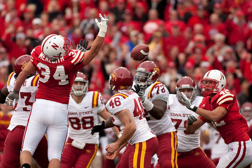 24 October 2009: Nebraska defensive end Cameron Meredith knocks down a Iowa State field goal attempt in the second half at Memorial Stadium, Lincoln, Nebraska. Iowa State defeated Nebraska 9 to 7.