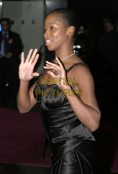 "JAMELIA.UK Gala premiere of ""Bridget Jones:The Edge of Reason"" London, 9th November 2004..halflength little black dress funny hands.Ref: AH.www.capitalpictures.com.sales@capitalpictures.com.©Capital Pictures."