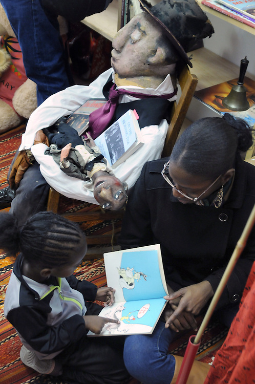 Aiden Blue, age 3, seen reading during the Naming Ceremony Event, at the A.J. Williams-Myers African Roots Community Center, at 43 Gill Street, in Kingston, NY, on Saturday, February 18, 2017. Photo by Jim Peppler; Copyright Jim Peppler 2017
