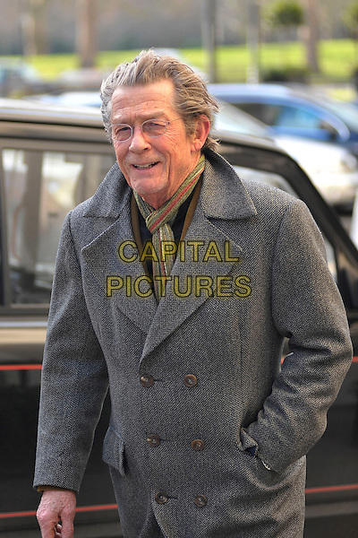 JOHN HURT.Spotted in London's West End, London, England..February 10th, 2010.half length grey gray coat jacket glasses hand in pocket scarf.CAP/DYL.©Dylan/Capital Pictures.