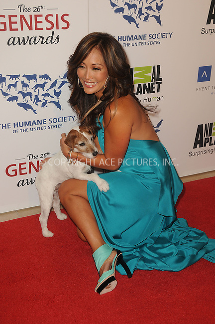 WWW.ACEPIXS.COM . . . . .  ....March 24 2012, LA....Carrie Ann Inaba and Uggy arriving at the 26th Annual Genesis Awards at The Beverly Hilton Hotel on March 24, 2012 in Beverly Hills, California. ....Please byline: PETER WEST - ACE PICTURES.... *** ***..Ace Pictures, Inc:  ..Philip Vaughan (212) 243-8787 or (646) 769 0430..e-mail: info@acepixs.com..web: http://www.acepixs.com