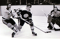 Boston Bruins star Bobby Orr..against Bert Marshall and goalie Gilles Meloche/ (1972/photo/Ron Riesterer)