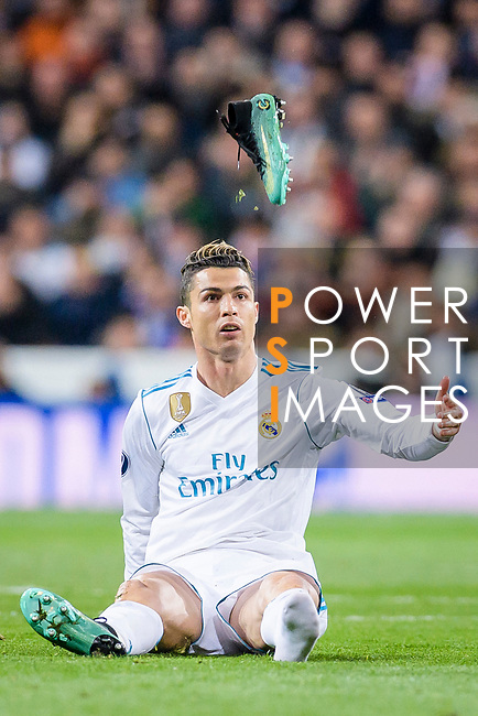 Cristiano Ronaldo of Real Madrid reacts as his boot flies through the air during the UEFA Champions League 2017-18 quarter-finals (2nd leg) match between Real Madrid and Juventus at Estadio Santiago Bernabeu on 11 April 2018 in Madrid, Spain. Photo by Diego Souto / Power Sport Images