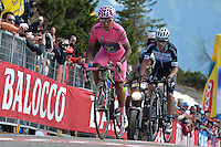 ITALIA. 31-05-2014. Nairo Alexander  Quintana Rojas -Col- (Movistar) (Izq) y Rigoberto Uran -Col- (Omega Pharma Quick-Step) (Der) durante su participación en la etapa 20 entre  Maniago y Monte Zoncolan con una distancia de 167 Km en la versión 97 del Giro de Italia hoy 22 de mayo de 2014. / Nairo Alexander  Quintana Rojas -Col- (Movistar) (L) and Rigoberto Uran -Col- (Omega Pharma Quick-Step) (R) during his participation on the 20th stage between Maniago and Monte Zoncolan with a distance of 167 km in the 97th version of Giro d'Italia today May 22th 2014 Photo: VizzorImage/ Gian Mattia D'Alberto / LaPresse<br /> VizzorImage PROVIDES THE ACCESS TO THIS PHOTOGRAPH ONLY AS A PRESS AND EDITORIAL SERVICE AND NOT IS THE OWNER OF COPYRIGHT; ANOTHER USE HAVE ADDITIONAL PERMITS AND IS  REPONSABILITY OF THE END USER