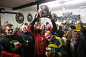 "17/02/15  <br /> <br /> 'Vince Brayne (34) celebrates with his ball after 'gaoling' a ball at the annual Royal Shrovetide Football  Match in Ashbourne, Derbyshire. After 'turning up' the ball at 2pm thousands of rival Up'Ards' and Down'Ards' team members attempt to 'goal' the ball onto stones set three miles apart in the town of Ashbourne, Derbyshire. The game also known as ""hugball"" has been played from at least c.1667 although the exact origins of the game are unknown but one of the most popular origin theories suggests the macabre notion that the 'ball' was originally a severed head tossed into the waiting crowd following an execution.<br /> <br /> <br /> All Rights Reserved - F Stop Press.  www.fstoppress.com. Tel: +44 (0)1335 418629 +44(0)7765 242650"