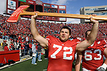 MADISON, WI - OCTOBER 14: Offensive lineman Joe Thomas #72 of the Wisconsin Badgers carries the Paul Bunyan Axe after beating the Minnesota Golden Gophers at Camp Randall Stadium on October 14, 2006 in Madison, Wisconsin. The Badgers beat the Golden Gophers 48-12. (Photo by David Stluka)