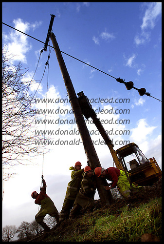 Scottish Power staff work to repair wind-damaged poles and lines - here at Knowton Farm near Shotts - as some blue sky returns  .... picture by Donald MacLeod 29.1.02