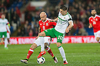 David Cotterill of Wales and Craig Cathcart of Northern Ireland during the International Friendly match between Wales and Northern Ireland at Cardiff City Stadium, Cardiff, Wales on 24 March 2016. Photo by Mark  Hawkins / PRiME Media Images.