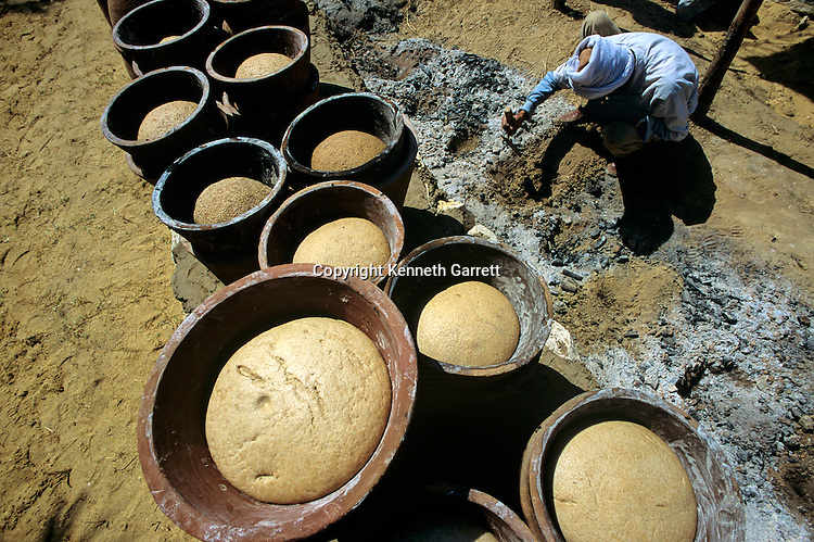 Egypt's Old Kingdom, Dough rising in pots at a reconstructed bakery using ancient methods, Dr. Mark Lehner, Giza