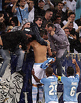 Calcio, Serie A: Lazio vs Palermo. Roma, stadio Olimpico, 2 settembre 2012..Lazio midfielder Antonio Candreva, center, celebrates with fans and teammates Abdoulay Konko, bottom center, and Stefano Mauri, bottom right, after scoring during the Italian Serie A football match between Lazio and Palermo at Rome's Olympic stadium, 2 September 2012..UPDATE IMAGES PRESS/Riccardo De Luca