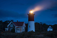 Nauset Light shines at night, Cape Cod National Seashore, Eastham, Cape Cod, MA, USA