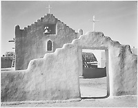 "Full side view of entrance with gate to the right, ""Church, Taos Pueblo National Historic Landmark, New Mexico, 1941."" [Misicn de San Gercnimo];<br /> From the series Ansel Adams Photographs of National Parks and Monuments, compiled 1941 - 1942, documenting the period ca. 1933 - 1942.<br /> Date 	<br /> <br /> 1941"