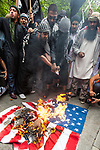 © Joel Goodman - 07973 332324 - all rights reserved . 11/09/2010 . London , UK . An American flag is set alight by supporters of Muslims Against Crusades , as they hold a demonstration outside the American Embassy in London on the 9th anniversary of the terrorist attack on the World Trade Centre and other targets in America . Photo credit : Joel Goodman