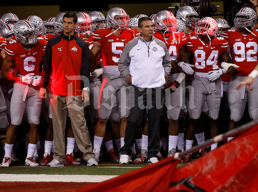 Ohio State Buckeyes head coach Urban Meyer  waits with his players in the tunnel prior to the Big Ten Championship game against the Wisconsin Badgers at Lucas Oil Stadium in Indianapolis on Dec. 6, 2014. (Adam Cairns / The Columbus Dispatch)