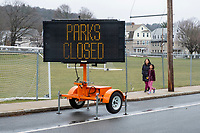 Signs and caution tape indicate that Town Field is closed in Belmont, Massachusetts, on Fri., March 20, 2020. Earlier in the week, the Town closed all parks, fields, courts, and playgrounds, as part of the lockdown response to the ongoing coronavirus COVID-19 pandemic.