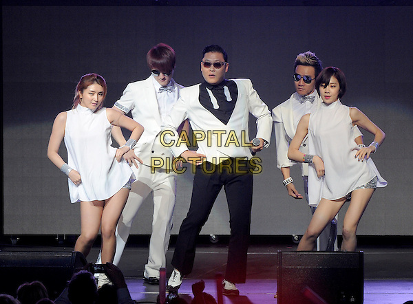 Psy (Park Jae sang).KIIS FM Jingle Ball Night 2 held at Nokia Live in Los Angeles, California, USA..3rd December 2012 .on stage in concert music gig performing live performance full length white sunglasses shades black jacket suit trousers hands on hips dancing   backup dancers .CAP/DVS.©DVS/Capital Pictures.