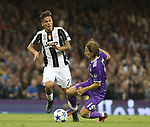 Paulo Dybala of Juventus in action with Luka Modric of Real Madrid during the Champions League Final match at the Millennium Stadium, Cardiff. Picture date: June 3rd, 2017.Picture credit should read: David Klein/Sportimage