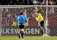DC United goalkeeper Troy Perkins pushes the ball over the crossbar. CD Chivas USA beat DC United 1-0 at Home Depot Center stadium in Carson, California on Sunday August 29, 2010.
