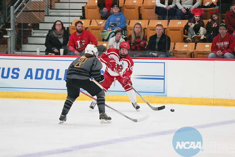 ADRIAN, MI - MARCH 18: Erin Brand (28) of Plattsburgh State University delivers a pass during the Division III Women's Ice Hockey Championship held at Arrington Ice Arena on March 19, 2017 in Adrian, Michigan. Plattsburgh State defeated Adrian 4-3 in overtime to repeat as national champions for the fourth consecutive year. by Tony Ding/NCAA Photos via Getty Images)
