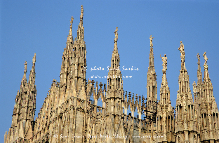 Iconic white pointed Gothic spires of the Milan Cathedral, Milan, Italy.