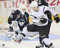 Milwaukee Admirals goaltender Atte Engren, left, watches as San Antonio Rampage's Michal Repik chases the puck in front of the net during the first period of an AHL hockey game, Tuesday, April 10, 2012, in San Antonio. (Darren Abate/pressphotointl.com)